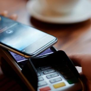 Customer using contactless payment with phone