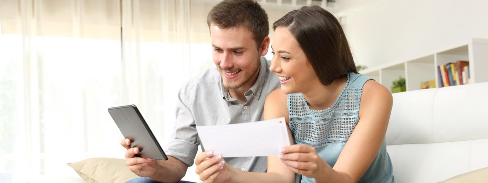 Couple looking at documents  - secure services specialises in card and document personalisation