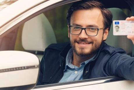 male showing driving license - specialist in e-identification and e-ID smartcard field